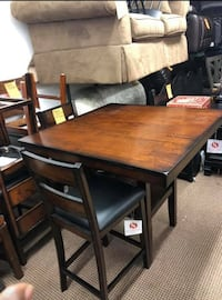 Nice countertop height dining room table with 4 chairs.