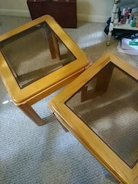 square brown wooden framed glass top coffee table 707 mi
