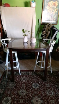 Set brown wooden table and white chairs