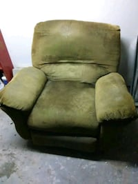 brown suede sofa chair with throw pillow