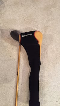 Black and orange taylormade golf club with cover