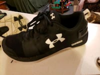 black-and-white Under Armour running shoes Woodstock