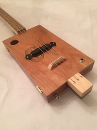 Cigar box guitar 3-string, maple neck, zebra wood fretboard, single-coil pickup, walnut heel and sealed tuners. Setup to use slide or fretting. This was hand crafted by Dana Jetton. Sapulpa, 74066