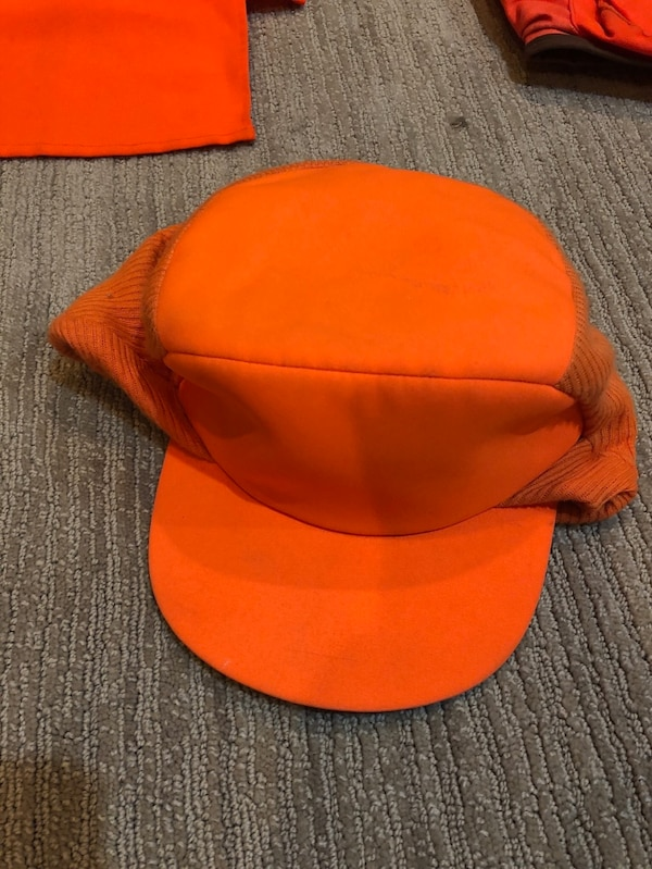 Medium orange hat.  fcad2aeb-0a63-4c6a-9c76-77f2aa5ff4cf