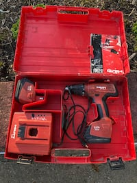 red and black Milwaukee cordless drill Central Islip, 11722
