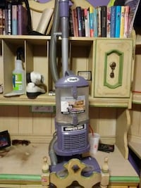 white and purple upright vacuum cleaner Wilson, 27896