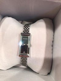 Gucci watch in stainless steel with diamonds