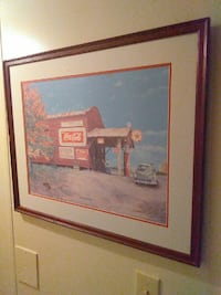 brown and red Coca-Cola gasoline station painting