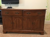 Brown wooden cabinet with hutch Ladue
