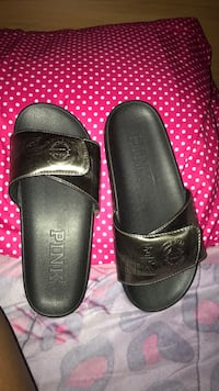 pair of black leather slide sandals