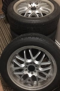 set of all weather rubber tires with alloy rims. universal 5 bolts