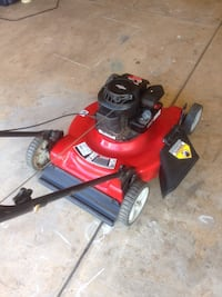 red and black push lawn mower yard machines powered by Briggs Stratton high wheeler 5.00h start right up