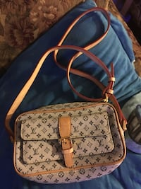 brown and white Louis Vuitton leather backpack Laredo, 78043