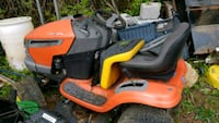 yellow and black ride on mower Highland, 20777