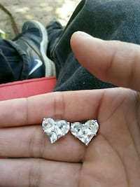 pair of silver-colored heart pendant earrings