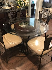 Round glass top table with four chairs dining set Beverly Hills, 90212