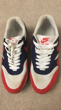 Pair of white-and-red nike air max running shoes