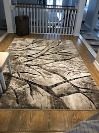 brown and black tree camouflage area rug