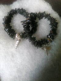 Stretchy is shell bracelets with charms
