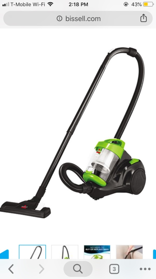green and black canister vacuum cleaner