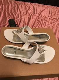 pair of white leather open-toe sandals