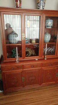 brown wooden display cabinet with candlesticks Vancouver, V6H 1P7