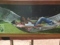 brown wooden framed painting of woman Colorado Springs, 80922