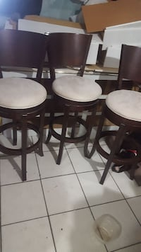 Three white padded bar stools Fort Lauderdale