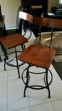 two brown wooden bar stools Laval, H7M 1K4