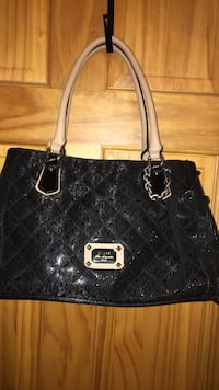 Guess handbag new condition black with tan straps