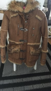 women's brown fur coat 540 km
