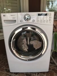 white LG front-load clothes dryer
