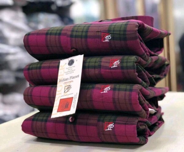 red and black plaid textile