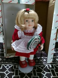 blonde haired female doll in white and red dress