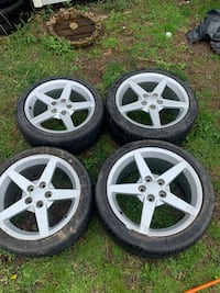 four gray 5-spoke car wheels with tires Amityville, 11701