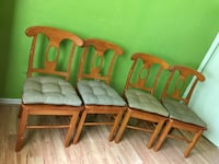 four brown wooden framed green padded chairs Ocala, 34479