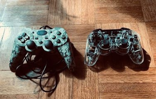 PS3 with 2 controllers and 11 games 18c44051-cc3a-4410-aa6b-cf242c2eea8d