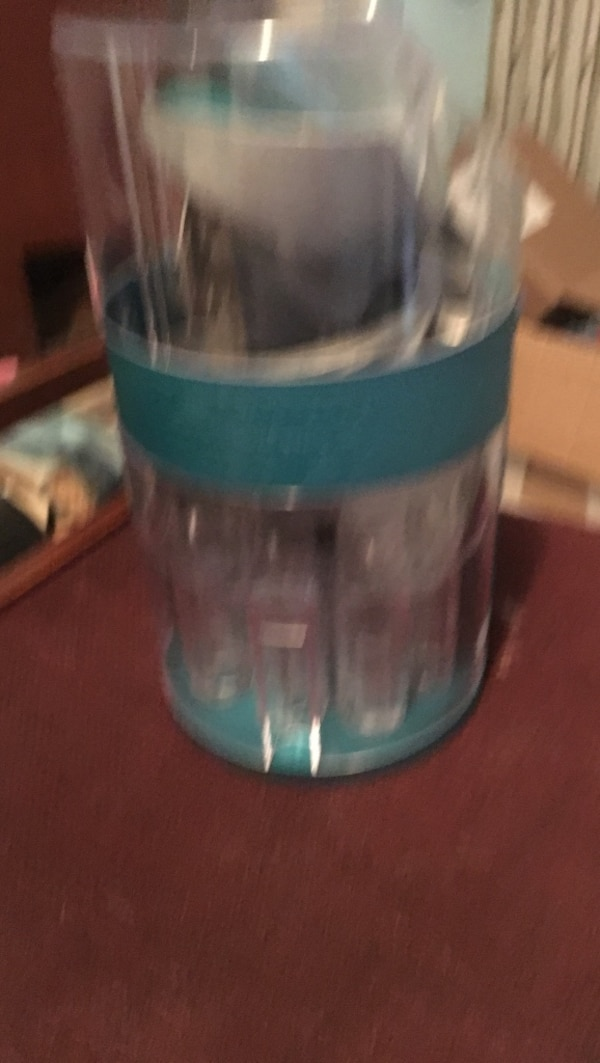 clear and teal plastic container