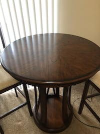 Round brown wooden hightop table Tampa, 33647