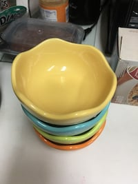 yellow, blue, green, and brown ceramic bowls