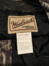 white, black, and red woolrick cloth label