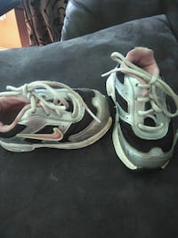 pair of gray-and-white Nike running shoes Clarksville, 37042