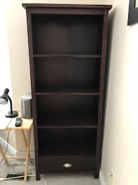 Espresso coloured shelving unit with a drawer at the bottom Surrey, V3W 2J9