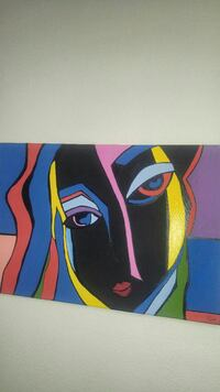 woman's face black, blue, yellow, and red painting Cabazon, 92230