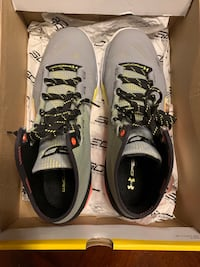 Pair of gray-and orange under Armour basketball shoes. Columbia, 21044