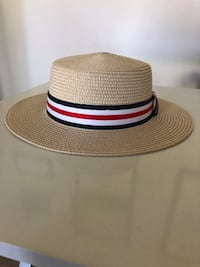 Beige fedora with red white and blue band