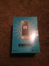 Silver and gray koodo flip phone.