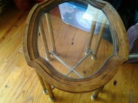 round brown wooden framed glass top table Center, 75935