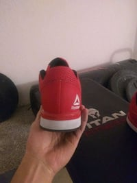 pair of red-and-black Adidas sneakers El Paso, 79902