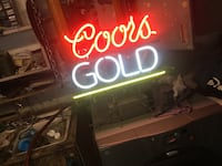 red and white Coors Gold neon light signage